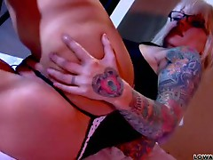 Tattooed chick shows pierced pussy teasing solo