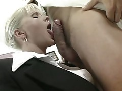 Horny secretary goes down on her knees to please boss's hard cock