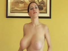 Young huge titted brunette jumping around and showing her boobs