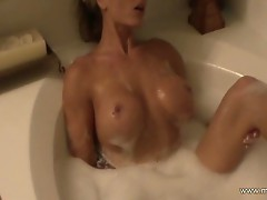 Busty blonde milf takes bubble bath and rubs pussy