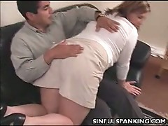 Chubby brunette spanked nice and hard