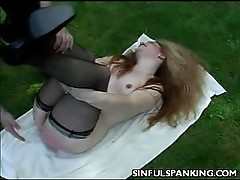Outdoor spanking with this redhead milf babe