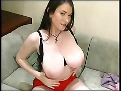 Tanya Song has huge tits and rubs them and her pussy to get off