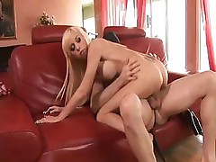 This blonde babe is going at it with gusto on this hard cock