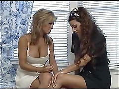 Two babes are fascinated by their assholes and play with them
