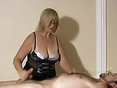 Big titted professional masseuse sensually massages client and his cock
