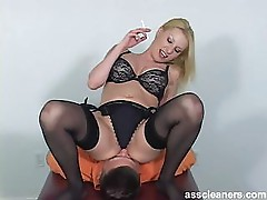 Blonde mistress in bikini facesits a man for ass licking while she's smoking
