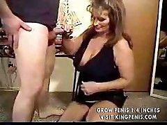Busty brunette mature keeps her boots on while she sucks dick