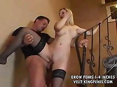 Busty blonde MILF sucks a cock and then fucks it on the steps