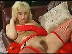 Red latex-dressed sweetheart is going happy