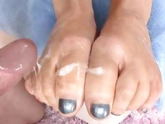 Awesome Abbey Brooks gets her toes covered in cum
