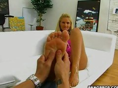 Great looking slut Phoenix Marie getting her feet licked in a foot-fetish action