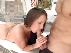 Kelly Divine grabs hold of cock while getting massage