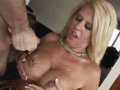 Seductive milf gets her round tits glazed with spunk