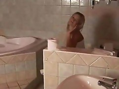 Blonde babe Masturbating in the bathrooms