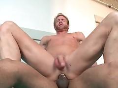 Blond stud riding big black jizzster