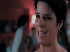 Neve Campbell stanDing Stark undressed in the Middle of a rEstaurant, holDing a wine glass as she Makes a speech wHile we See her breasts. we also See