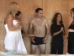 Pervy male masseuse is forced to strip and have wanked by four females