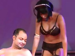 Sexy brunette having wet onto the stage