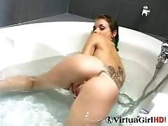 Sandra plays in the bath
