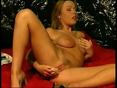 Blonde fondles her pussy