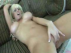 Tanya James stimulates her busty body