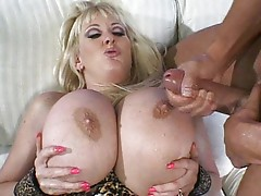 Blonde with balloon tits sucks