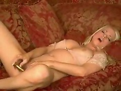 Hot blonde playing with vibrator