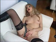 Blond smoking prostitute masturbating
