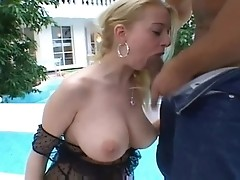 Big titted blonde honey getting nailed by the pool