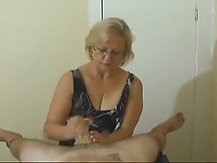 Mrs Watson is elderly mom massaging cock on camera