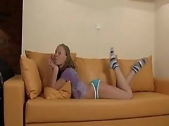 Young Becky Poses On Couch