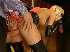 Blonde slut in latex double-teamed (Brigitta Bui)
