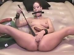 Gagged Antonia masturbates with dildo & pistil
