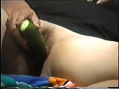 milf Joy with a cucumber
