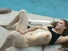 Stunning brunette dame lights up the pool