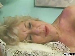 Mature blonde plays with shiny dildo