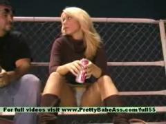 A young blonde discuss stadium