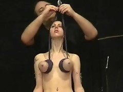 Slim model experiences kinky punishment of tits