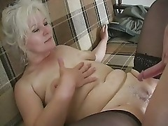 Mature European lady likes cum on her belly