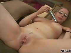 Young chubby blonde sticks vibrator in cunt