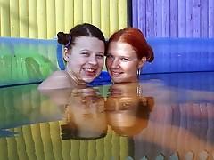 Lesbian teens in a pool