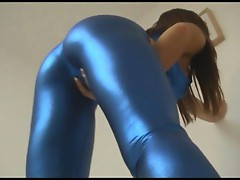 Cate Harrington masturbating in shiny blue outfit