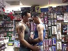 Two gays are fucking each other in the video store