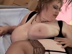 BBW babe in black stockings gets nailed doggy way