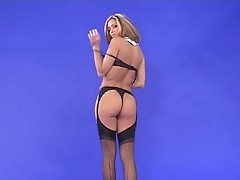 Clara Morgane takes off all except of stockings
