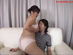 Busty Milf In Lingerie Getting Her Nipples Sucked Giving Blowjob For Young Guy On The Couch