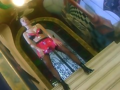 Milf teases in a latex skirt stockings and boots
