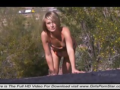 A very sexy blonde masturbating passionately in nature