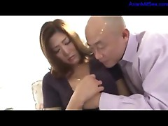 Milf Getting Her Tits Rubbed Pussy Licked By Bald Guy On The Couch In The Room
